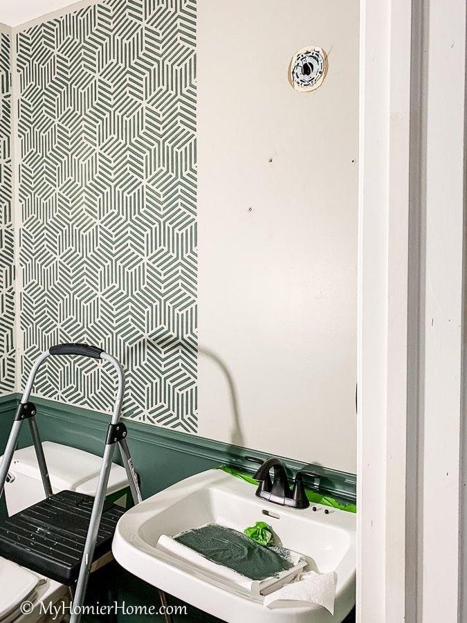 Looking for a budget-friendly way to update your bathroom walls? Here are all my tips for creating a bathroom wall stencil that makes a huge statement.