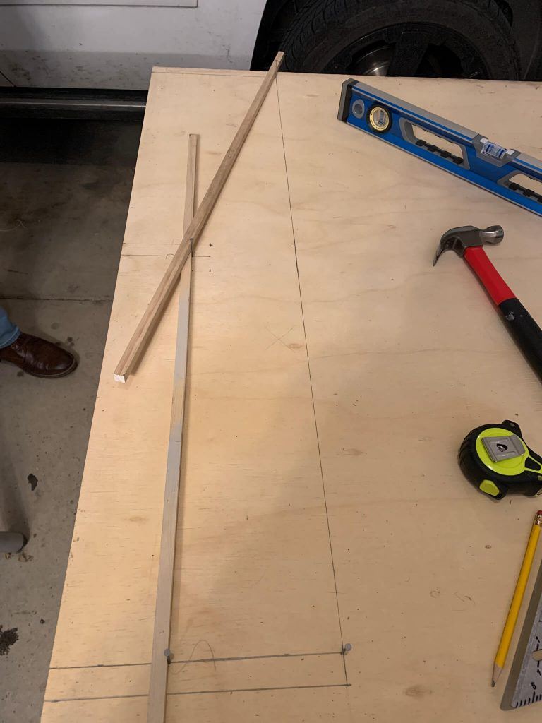 setting up the small boards to make the DIY archway guide