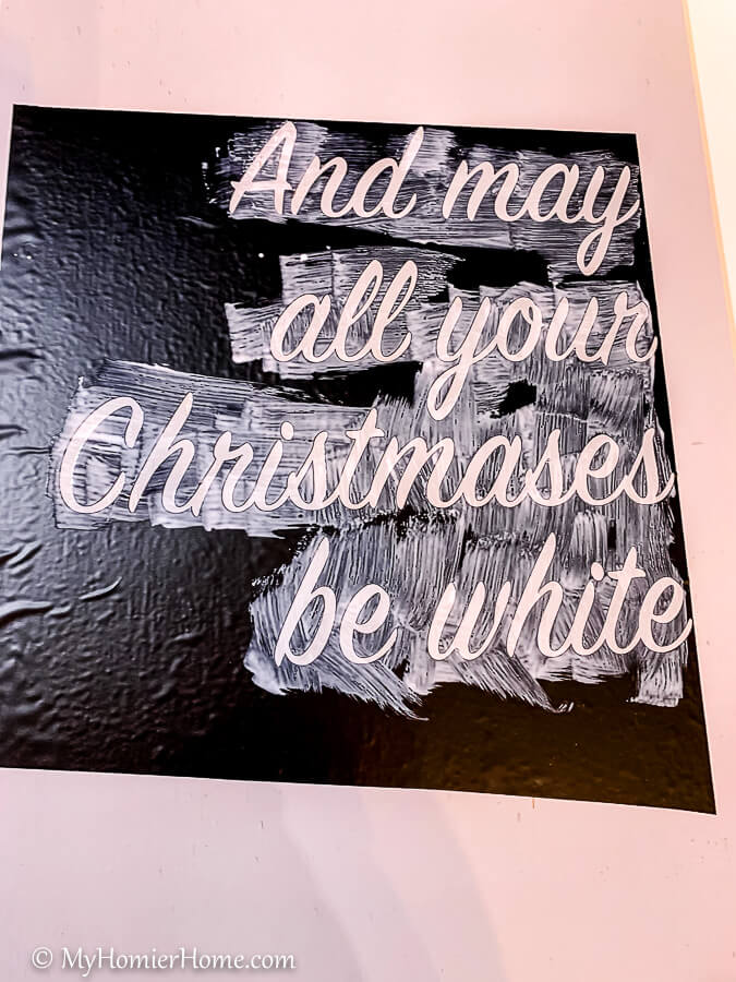 Add matte mod podge to the top of your stencil for the DIY Christmas wood signs