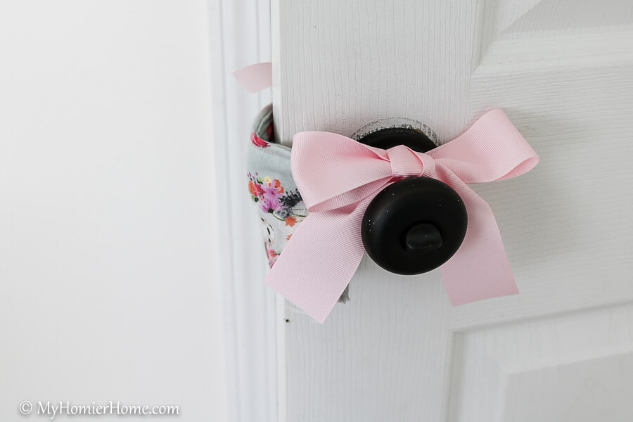 Learn how to easily create your DIY door muff to make sure the clicking of the door doesn't wake your sleeping baby. Check it the full tutorial here.