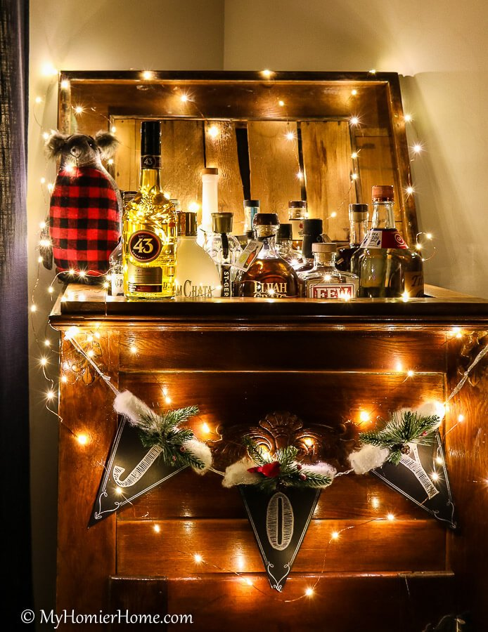 Licor 43 surrounded by holiday lights on a vintage ice chest turned bar cart.