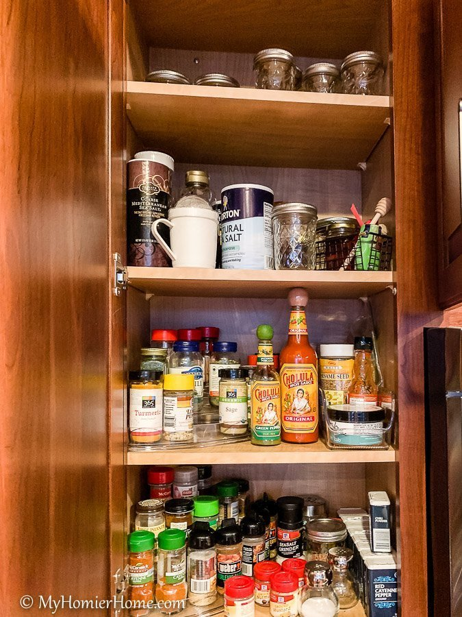 How to organize your kitchen cabinets using clear and simple strategies to tackle kitchen cabinet dysfunction without losing your mind. The spices cabinet before... yikes!