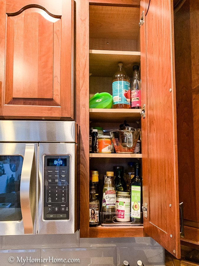 How to organize your kitchen cabinets using clear and simple strategies to tackle kitchen cabinet dysfunction without losing your mind. The oil and miscellaneous cabinet before... yikes!