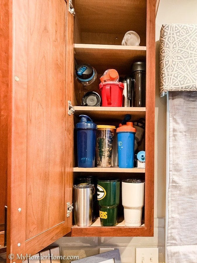 How to organize your kitchen cabinets using clear and simple strategies to tackle kitchen cabinet dysfunction without losing your mind.