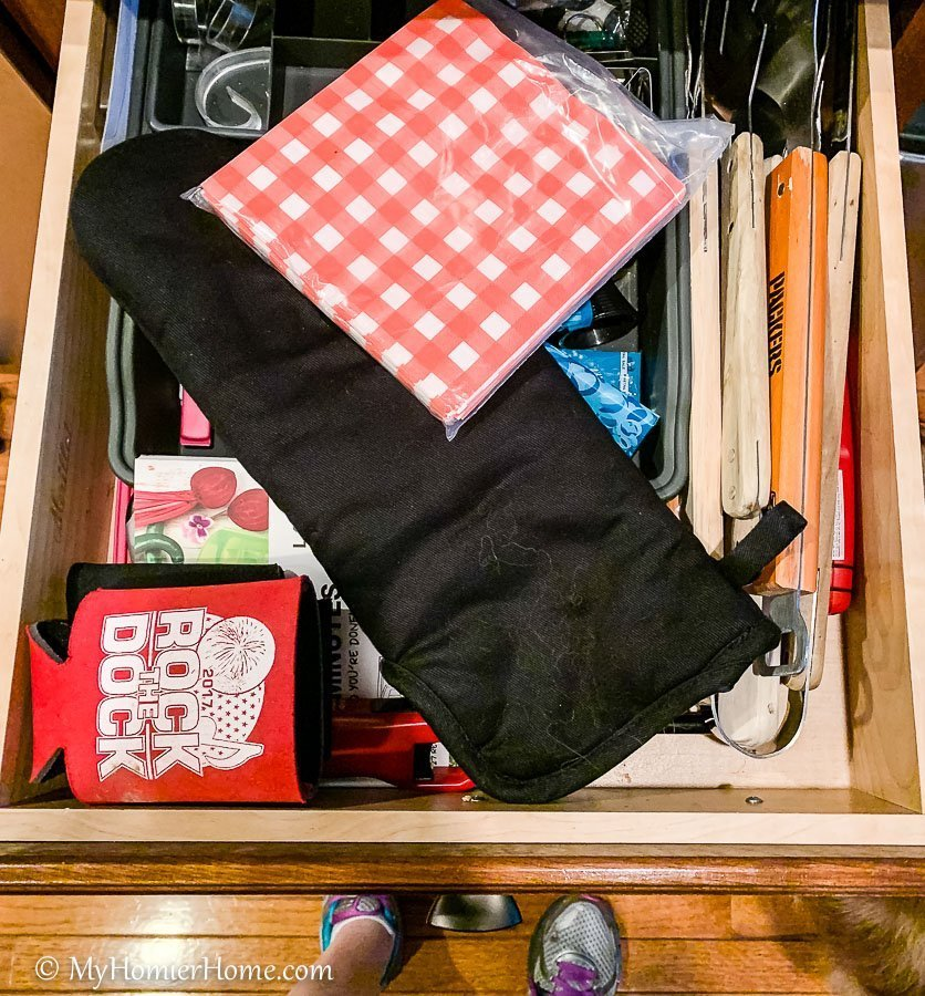 How to organize your kitchen cabinets using clear and simple strategies to tackle kitchen cabinet dysfunction without losing your mind. The infamous junk drawer now turned coffee and tea station!
