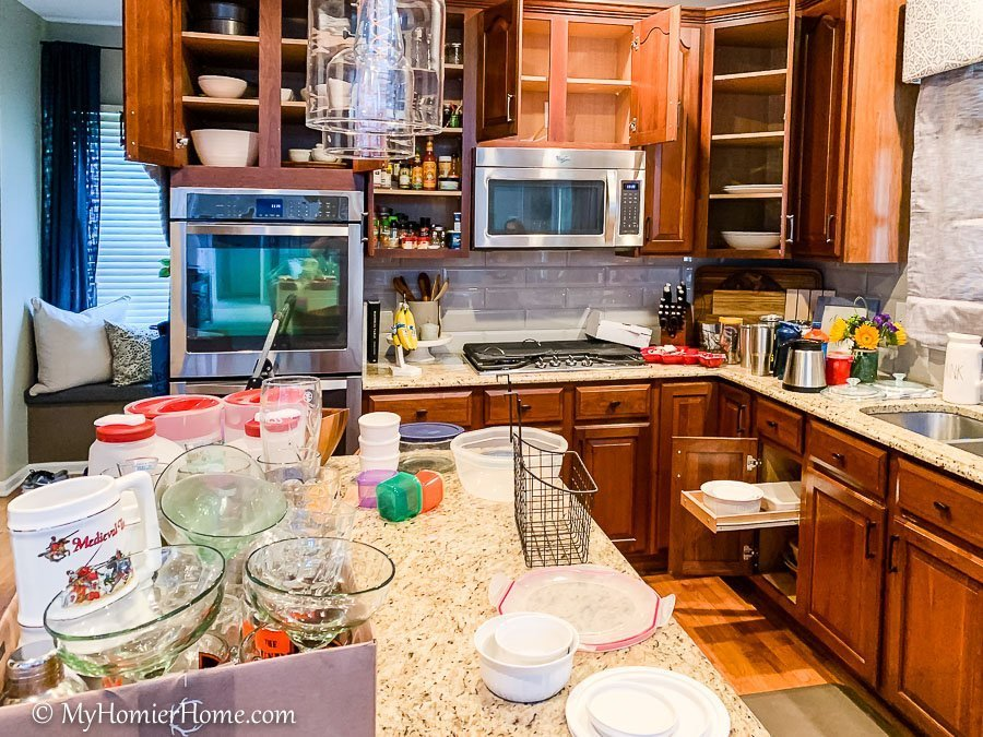 Use separate boxes to house items that belong in another room. How to organize your kitchen cabinets using clear and simple strategies to tackle kitchen cabinet dysfunction without losing your mind.