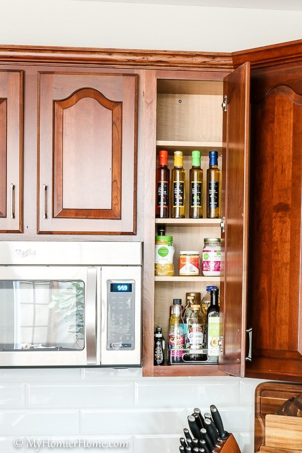 How to organize your kitchen cabinets using clear and simple strategies to tackle kitchen cabinet dysfunction without losing your mind. The oil and miscellaneous cabinet after... oh ya!