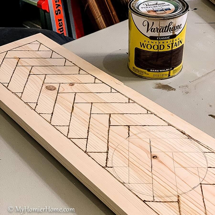 Stain the wood herringbone pattern