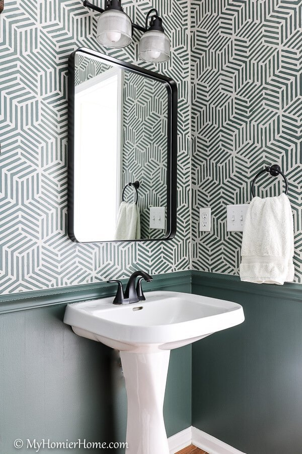 You won't believe the before and after photos of this powder room makeover. Phase 1 was completed for $100 and phase 2 gives the finishing touches!